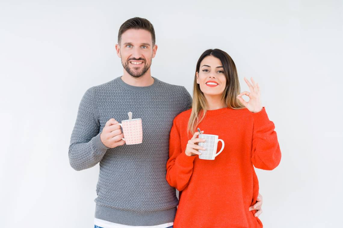 Young Couple Drinking Cup Of Coffee